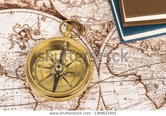 Compass On Vintage Ancient Map Book: stock fotografie (k okamžité úpravě) 1368621005 Ancient Map, Compass, Book, Image, Book Illustrations, Books