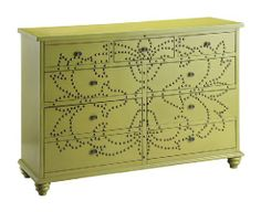 Add the element of instaglam to your bedroom or living room with a hand-painted avocado dresser, designed with antique brass nailheads for a stylish finish. | Avocado Nailhead Dresser cort.com