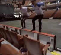 Josh and Brendon  doing a backflip together, this is awesome. (Brendon's wearing his S'cute shirt.)