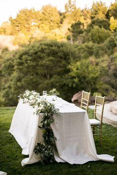 Sweetheart table, cascading eucalyptus, gold Chiavari chairs // Yuliya M. Photography