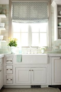 Love the sink and the roman shade