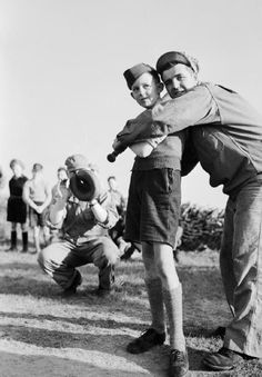 American Soldiers teaching British children how to play baseball during WW2 ~