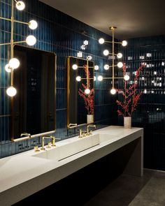 blue tiles, stone double vanity, pendant lights