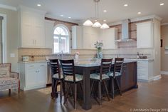 This Lititz PA kitchen remodel transformed a dated cherry kitchen into a timeless black and white classic kitchen and dining area.