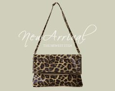 Today's Hot Pick :Leopard Print Bag http://fashionstylep.com/SFSELFAA0001041/righthen/out Superbly eye-catching leopard print bag with metal snap closure on flaps, fully lined interior, zippered compartment, and detachable slim strap. Ideal for a date-worthy outfit plus sleek leather pumps.
