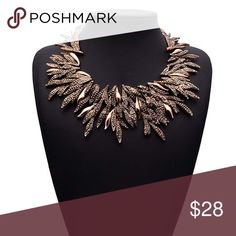 "Bronze Gold Leaf Bib Collar Statement Necklace A great addition to your fall and winter  wardrobe, this item isn't found anywhere but in my closet! Chain length measures 15"" with a 2"" extender. Necklace center design measures 3"" long and the leaf design encircles the entire item. Purchase for yourself or as a holiday gift for your fashion forward mother, daughter or sister! Bedecked & Bedazzled Jewelry Necklaces"