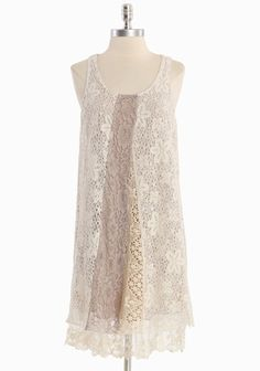 """For Eternity Lace Dress 74.99 at shopruche.com. This oh-so-charming floral lace dress in ivory is crafted with cream crocheted and mauve lace panels. Finished with a raw edge for texture, a scalloped lace hem, and a soft taupe lining for a subtle hint of color. Fully lined.Lining: 100% Cotton, Self: 35% Polyester, 65% Cotton, Imported, 37"""" length from top of shoulders, 34"""" bust, All measurements are taken from a s..."""