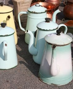 Antique watering cans and coffee pots. I have a small collection from France and England.