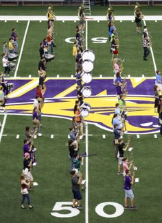 UNI marching band performing on the University of Northern Iowa football field.