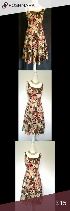 """Nine West Flare Dress size 2 Nine West pre-owned dress in excellent condition, No rips, holes or stains. Ivory with brown, black, tan, peach flowers  Corset ribbing, Lined breast area  Back zipper  SIZE: 2 Measurements taken while item is laying flat.  BUST: 15.5"""" WAIST: 13"""" HIP: 16"""" LENGTH: 28.5""""  I will be happy to measure or answer any questions regarding the item. Nine West Dresses Midi"""