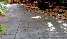 Ashlar pattern is one of our most popular decorative concrete stamp patterns and can be colored to complement other hardscapes, such as rock. #StampedConcrete #StampedPatio #AshlarPattern