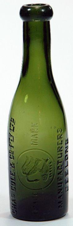 Chas Cole & Co Pty Ltd Manufacturers Geelong. Heron & Fish trade mark. Dark green glass blob top soda bottle.