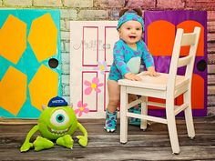 One of the pictures from my sons first birthday photos. His birthday party is Monsters, Inc theme, so some of his pictures follow this theme. I made the doors for his party. Credit: My JLP Photography