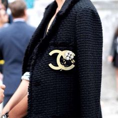 """A Chanel brooch makes any item special. Our vintage Chanel """"CC"""" logo brooch will ensure that you stand out in a crowd. http://luxurygaragesale.com/collections/designer-chanel/products/gold-toned-and-black-reverse-color-block-cc-logo-circle-pin-brooch"""