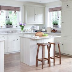 Love these cabinets and island/breakfast bar