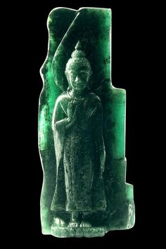 """Largest carved emerald in the world. This classic standing Buddha posture is known as Harm Yhard. """"Sacred Emerald Buddha."""""""