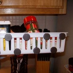Attach magnets to small plastic baskets to make a nifty spice rack that fits on the side of your fridge. | 15 Smart Dollar Store Ideas To Declutter Your Kitchen