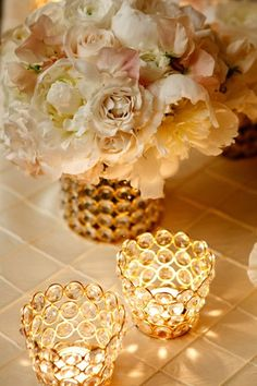beautiful white and blush floral centerpiece with crystal and gold votive candles. so romantic.
