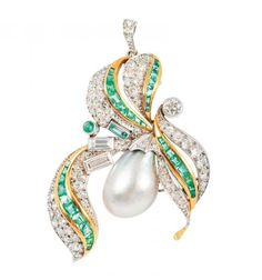 A rare natural pearl diamond emerald brooch  Around 1930. Probably platinum with yellow gold. The light grey natural pearl with light multicoloured lustre of silver, green until aubergine (approx. 15 x 11 mm). In pavé and bezel setting with 73 diam. in old, transition, 8/8 and baguette cut in total approx. 1,80 ct. H-I.vsi-si. and with 35 emeralds in emerald, trapez, carrée and cabochon cut. Can be worn as a pendant as well. 45 x 37 mm, weight approx. 12 g. Confirmation of the Gemmologisches…
