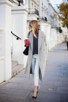 Winter Outfit Inspiration: Long gray coat over a sweater, lace-up skinny jeans, and heels.