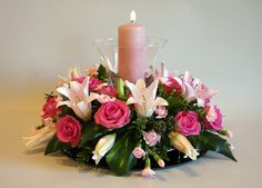This arrangement woul be suitable for a table centrepiece for a dinner party, anniversary celebration, etc.