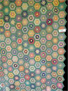 Antique 1930's Garden quilt exhibited by Lynn Kough. Quilt Inspiration: Grandmother's Flower Garden.
