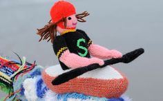 Detail of a figure adorning the Olympics-themed knitted railing scarf.  Creator unknown.