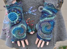 The colors of these gloves are so dreamy! Teal, aqua, gray, and dark blue spiral together to form these one of a kind gloves. Theyre super comfortable and