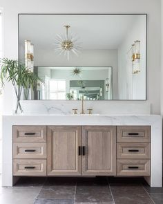 KerryKirkPhoto on Still swooning over this bathroom vanity amp; cabinet situation by davidjames_custombuilder and tc_interiors So beautifully done! Modern Bathroom Design, Bathroom Interior Design, Home Interior, Modern Bathroom Mirrors, Bathroom Lights Over Mirror, Contemporary Bathrooms, Bathroom Chandelier, Master Bathroom Vanity, Modern Master Bathroom