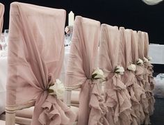 Truly Scrumptious Wedding's beautiful vintage pink chiffon ruffle hoods with ivory rose. Set up included at £1.40 or complete with chair cover too for £2.30 (www.trulyscrumptiouswedding.co.uk)