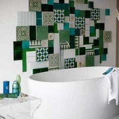 Green & white patchwork tiles on bathroom wall #badkamer