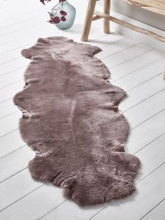 Supplied and hand finished in the UK, this rug has been made from natural short-haired sheepskin in an exquisite toned mink colour. This double rug makes a sumptuous decorative detail for the back of your sofa, on top of a bench or beside your bed. Mink Colour, Cox And Cox, Sheepskin Rug, Scandinavian Furniture, Colour Board, Rug Making, Soft Furnishings, Animal Print Rug, Rugs