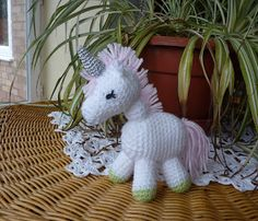 PDF version Meet Charley the Unicorn - so irresistible. Yarn – White DK yarn plus small amounts of green, pink and black. Silver lurex ...