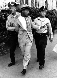 Martin Luther King being arrested for demanding service at a white-only restaurant in St. Augustine, Florida, 1964.