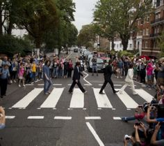 """The cast of the West End Beatles musical show """"Let it Be"""" pose for photographers by attempting to recreate the cover photograph of the Beatles album """"Abbey Road"""" on the zebra crossing on Abbey Road in London. (Photo by Matt Dunham—AP) Beatles Album Covers, Beatles Albums, John Lennon Beatles, The Beatles, Beatles Art, Ringo Starr, George Harrison, Paul Mccartney, Abbey Road London"""