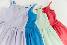 $46 | Pips and Poppy 'Heather Dress' in Lavender, Blueberry, Sweet Mint and Rosy Red. Button-up sundress made with 95% soft cotton and 5% spandex. The cutest, most comfortable kids summer dress! #littlegirlsdress #girlsclothes Little Girl Summer Dresses, Little Girls, Red Button, Summer Looks, Poppy, Blueberry, Lavender, Mint, Spandex