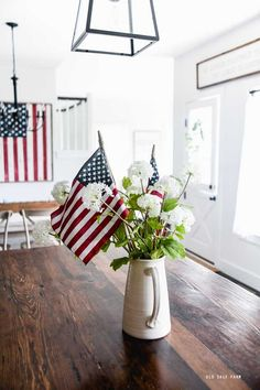 Farmhouse Summer Home Tour #farmhousestyle #farmhousedecor #summerdecor #homedecor #sumnmerhomedecor #farmhousesummerdecor #patrioticdecor #americanadecor #redwhiteandbluedecor #flagdecor Farmhouse Style Decorating, Farmhouse Decor, Pitchers Of Flowers, Patriotic Decorations, Table Decorations, Happy Memorial Day, White Home Decor, Flag Decor, Better Homes And Gardens