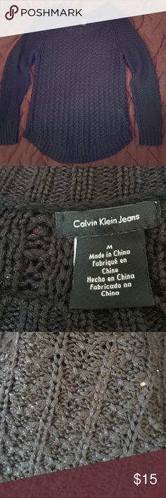 """Calvin Klein Jeans Knit Sweater Black dressy sweater from Calvin Klein. So beautiful, but I received it as a gift and it hangs a little weird on me. Photos don't do it any justice. I'm 5'8"""" and it hits mid hip on me. So cute with a collared shirt underneath! Calvin Klein Jeans Sweaters Crew & Scoop Necks"""