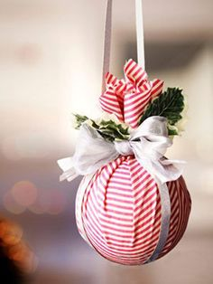 Bright handmade Christmas balls are simple and easy to make. Wrap an old Christmas ball, used tennis ball or any plastic ball with a square piece of colorful decorative fabric in colors that match your Christmas tree decorating. Use the rubber band to hold fabric.