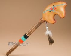 This is a genuine Native American Navajo Indian rawhide rattle shaker perfect for dance, music and medicine. This Native American rattle features a hand stitched and painted rawhide bear shaker. The h