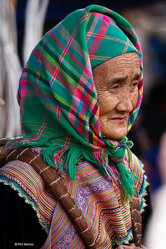 Asia | Portrait of an old Flower Hmong woman with traditional headscarf, Vietnam | © Phil Marion