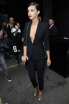 Taking the plunge: The former TOWIE star dared to bare as she went braless in a black trou...