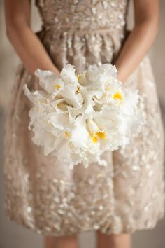 bouquet. Oscar de la Renta dress.
