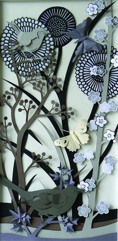 This woman's work is a ridiculously intricate and beautiful piece of Paper sculpture. Projects in this Pin board, 'Slice a lá QVC' do not all use shapes I have, but they illustrate what you can make or do with a bunch of  individual cuts and some artisans  inspiration. check my Pin board 'Slice Design Cards for a definitive list of 50 with a rough average of 100 shapes.