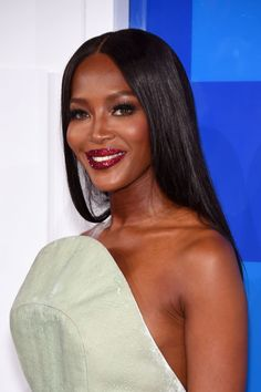 Naomi Campbell rocked ruby red glitter lips by celebrity makeup artist Pat McGrath.