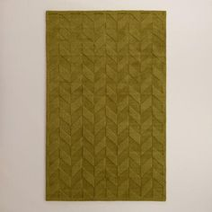 Hand tufted in a playful green hue, our exclusive area rug boasts a hand-carved chevron design that exudes a unique textural depth. A great rug for any room with a soft underfoot feel, its upscale look is available for an exceptional value.