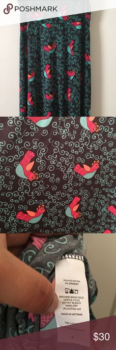 LuLaRoe Maxi Skirt/Dress (Small) EUC Black background with sky blue swirls. The birds are a blend of sky blue, bright pink, orange, and dusty yellow. Worn once and washed to LLR standards. Excellent used condition. Size Small (6-8) •DISCLOSURE: 🐶My pets don't smoke, but I do.🐶• LuLaRoe Skirts Maxi
