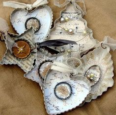 Cut out music or book pages, glue in and add some vintage bling inside old tart tins or cookie cutters.