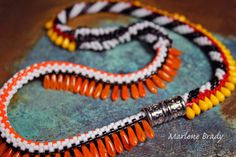 Marlene Brady. Russian spiral focal, magnetic closure, Circus Stripes pattern for sides of necklace.