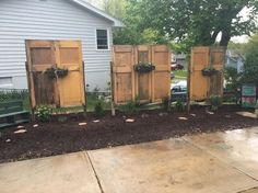 old doors give new life to backyard , container gardening, doors, gardening, repurposing upcycling Diy Concrete Planters, Large Planters, Concrete Pavers, Concrete Bags, Decorative Planters, Cement, Bags Of Mulch, Gravel Patio, Building A Pergola